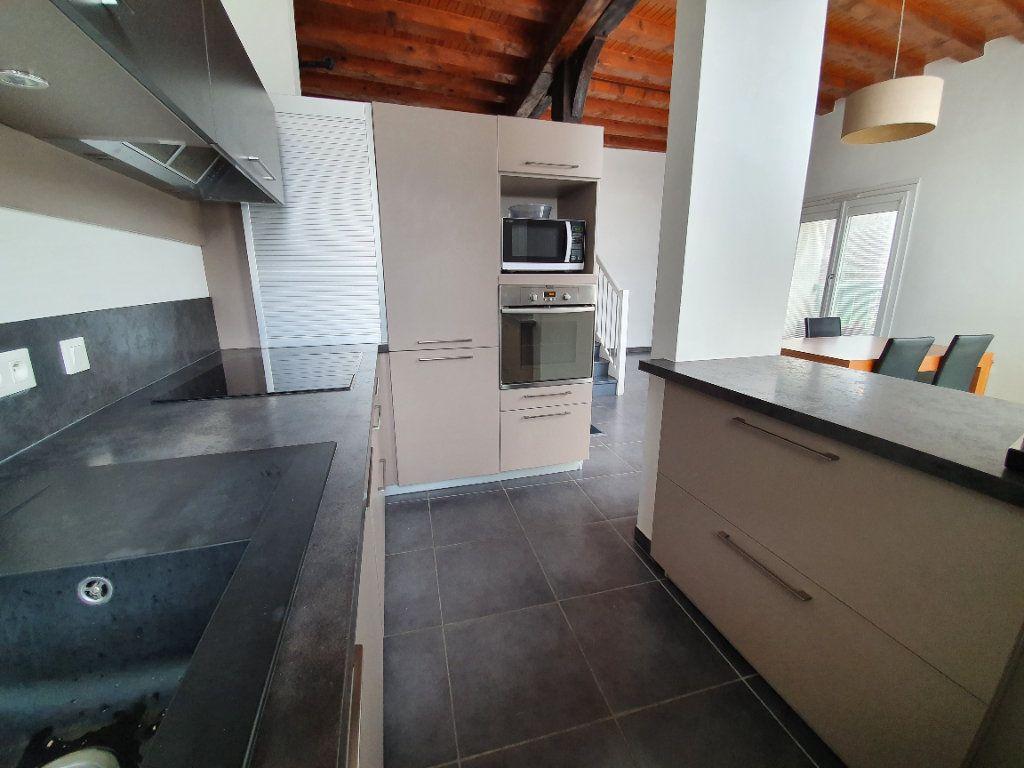 Appartement à vendre 4 101m2 à Saint-Jean-de-Gonville vignette-3