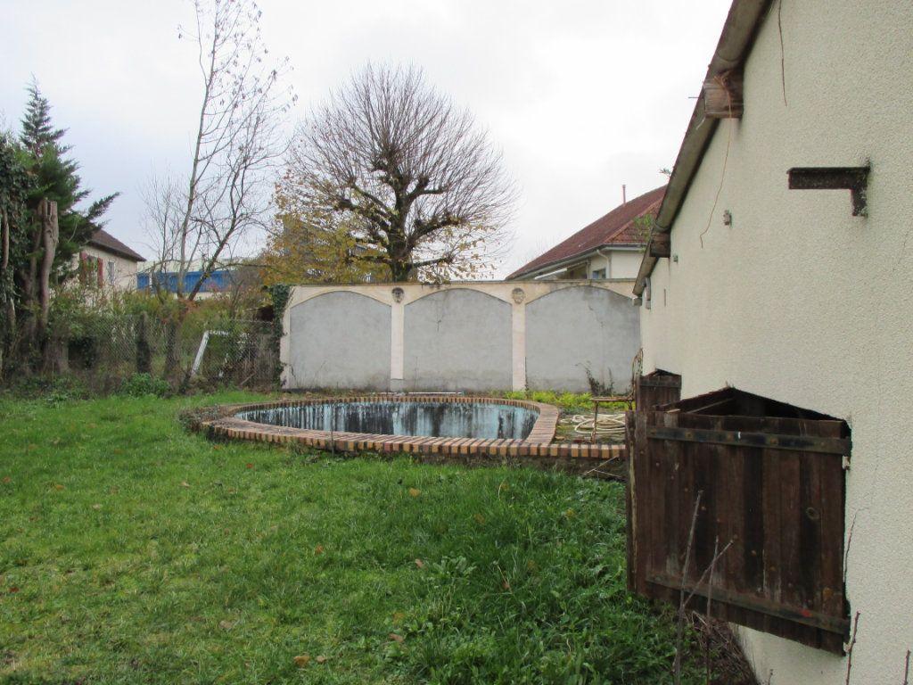Maison à vendre 5 135m2 à Bourges vignette-8