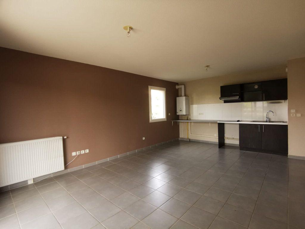 Appartement à vendre 3 59.34m2 à Saint-Geniès-Bellevue vignette-2