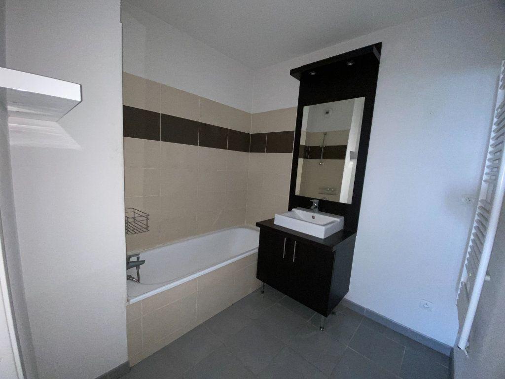 Appartement à vendre 3 59.34m2 à Saint-Geniès-Bellevue vignette-4