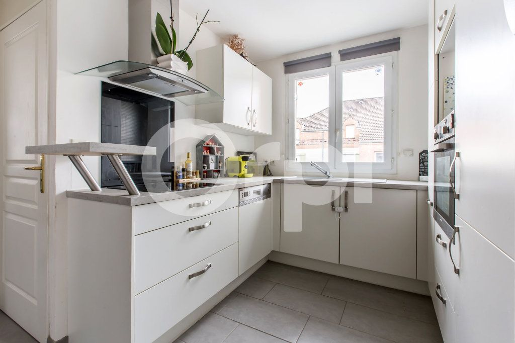Appartement à vendre 3 58m2 à Lys-lez-Lannoy vignette-1