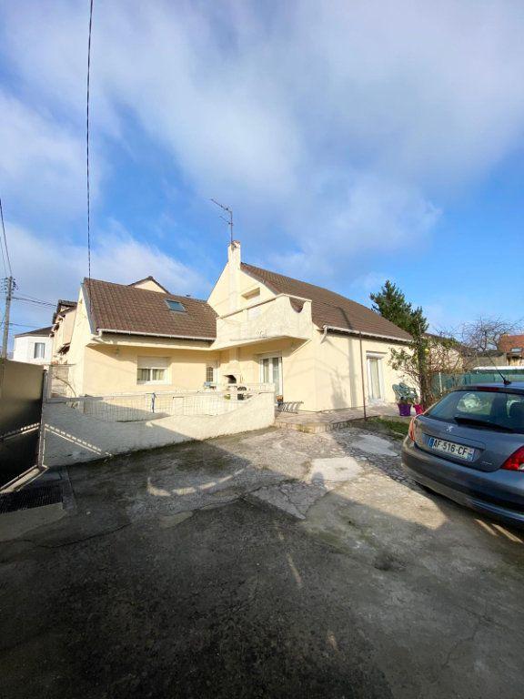 Maison à vendre 8 143m2 à Goussainville vignette-1