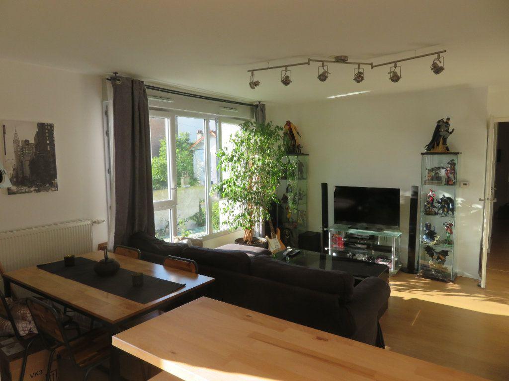 Appartement à vendre 3 65.94m2 à Épinay-sur-Seine vignette-12