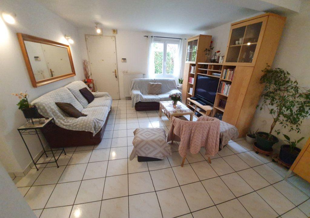 Maison à vendre 6 101.58m2 à Les Pavillons-sous-Bois vignette-2