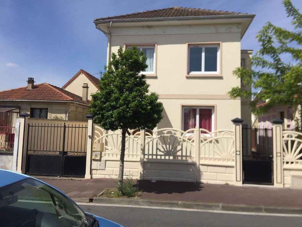 Maison à vendre 6 124.85m2 à Garges-lès-Gonesse vignette-1