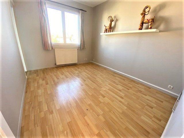 Maison à vendre 6 124.85m2 à Garges-lès-Gonesse vignette-5