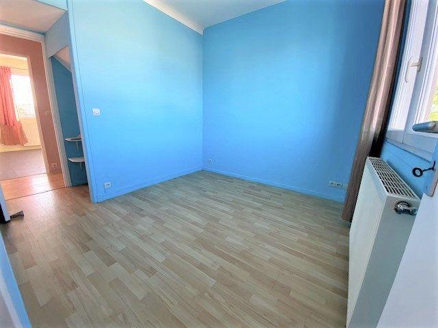 Maison à vendre 6 124.85m2 à Garges-lès-Gonesse vignette-6