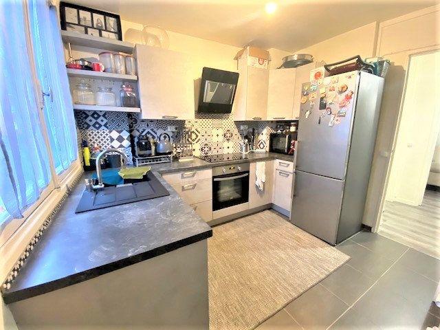 Appartement à vendre 4 67.19m2 à Arnouville vignette-4