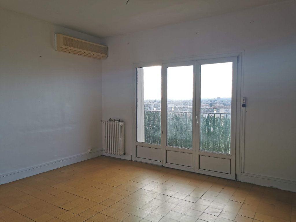 Appartement à vendre 4 68m2 à Nîmes vignette-1