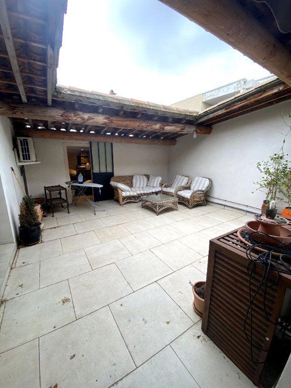 Appartement à vendre 7 164.1m2 à Nîmes vignette-1