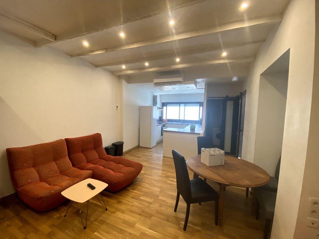 Appartement à vendre 7 164.1m2 à Nîmes vignette-6