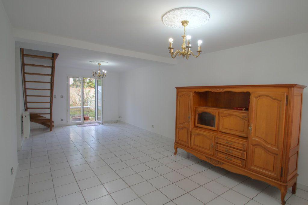 Maison à vendre 5 90m2 à Saint-Jean-de-la-Ruelle vignette-1