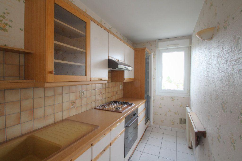 Appartement à vendre 3 57m2 à Saint-Jean-de-la-Ruelle vignette-2