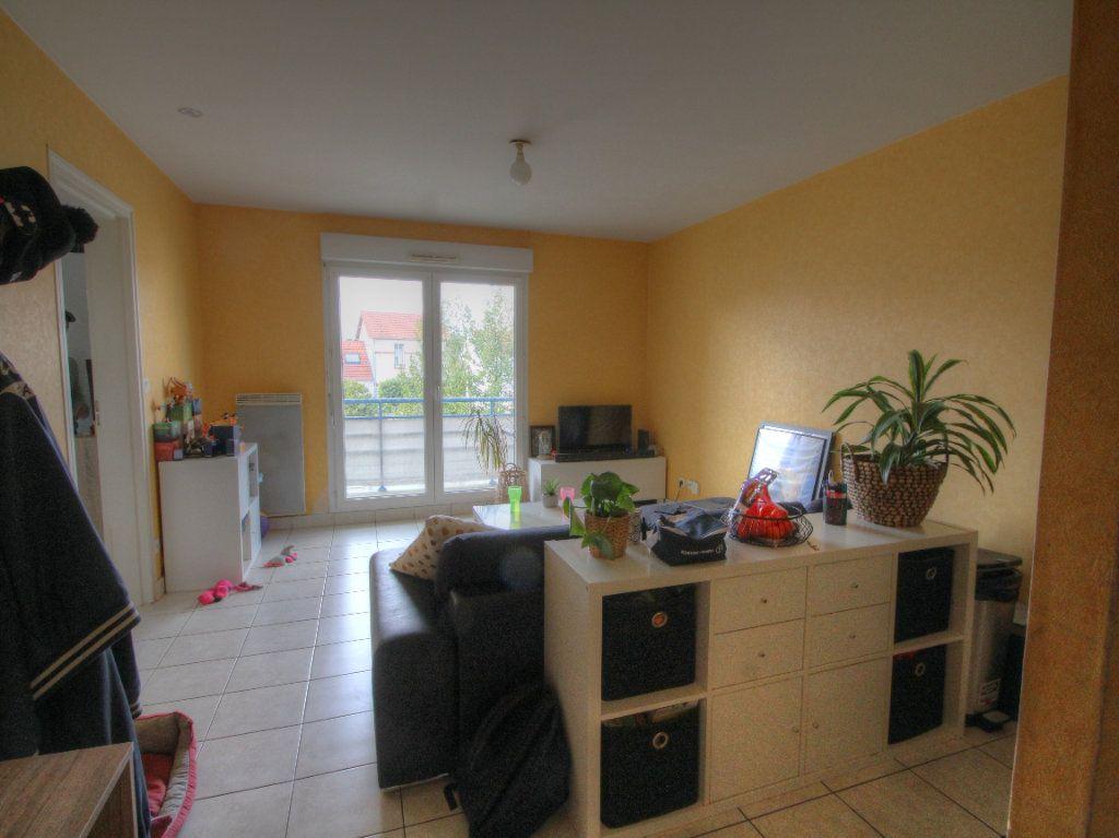 Appartement à vendre 2 42m2 à Fleury-les-Aubrais vignette-2