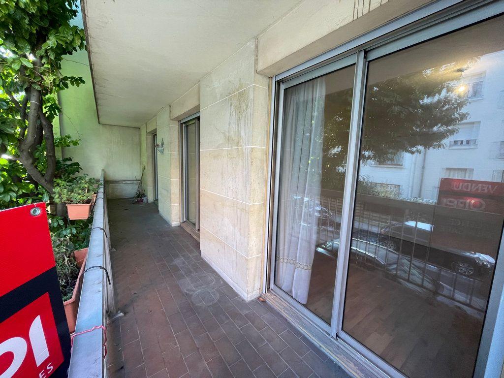 Appartement à vendre 5 82.95m2 à Asnières-sur-Seine vignette-2