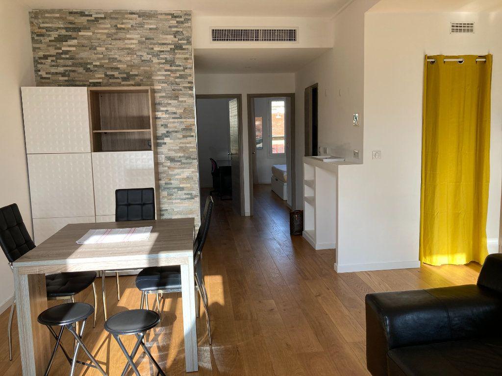 Appartement à louer 3 59.51m2 à Nice vignette-4