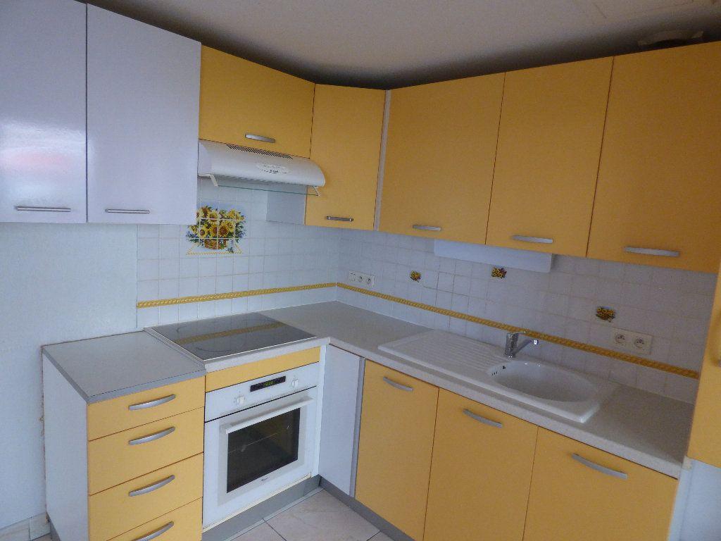 Appartement à vendre 2 57m2 à Fréjus vignette-3