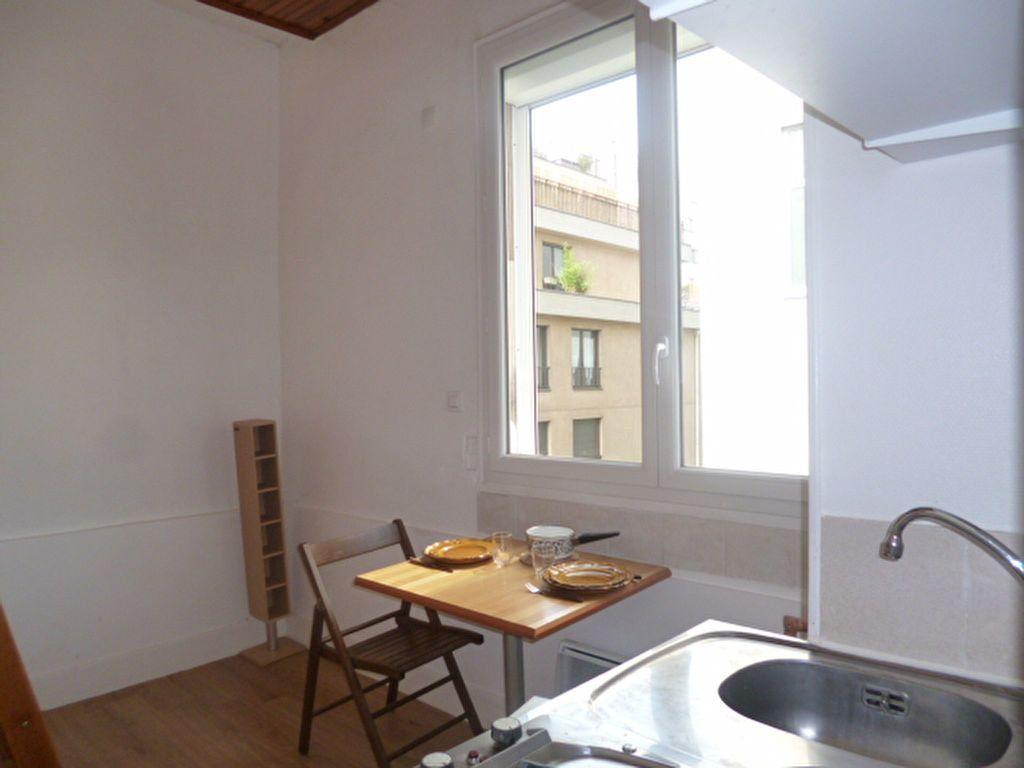 Appartement à louer 1 11m2 à Paris 14 vignette-3