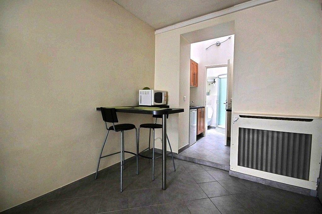 Appartement à louer 1 20.11m2 à Paris 14 vignette-1