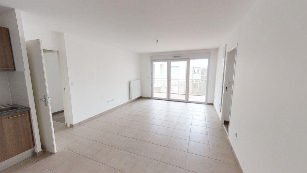 Appartement à louer 3 55.12m2 à Toulouse vignette-2