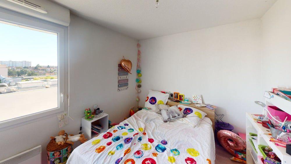 Appartement à vendre 3 56.41m2 à Toulouse vignette-4