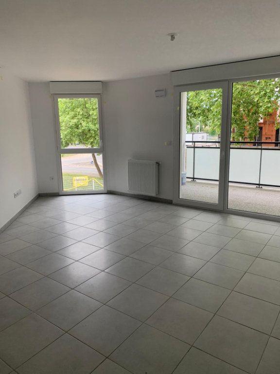 Appartement à louer 3 57.95m2 à Saint-Jory vignette-2