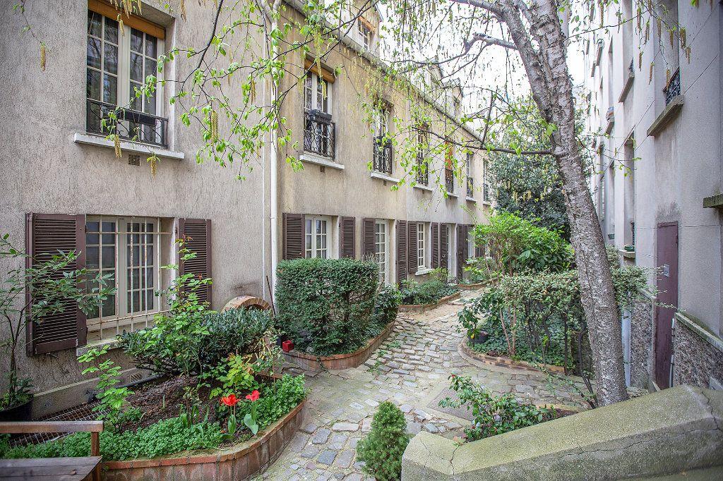Appartement à vendre 7 148.57m2 à Paris 14 vignette-3