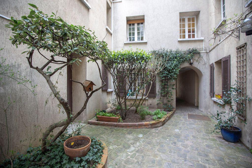 Appartement à vendre 7 148.57m2 à Paris 14 vignette-10