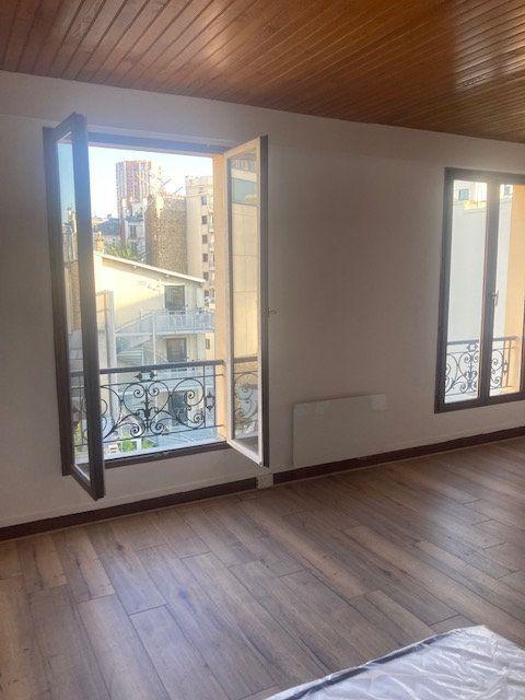 Appartement à louer 1 30m2 à Paris 13 vignette-1