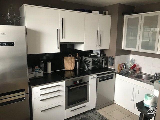 Appartement à louer 3 65.59m2 à Rosny-sous-Bois vignette-5