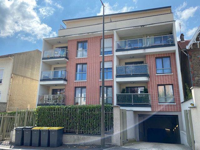 Appartement à louer 2 51.4m2 à Rosny-sous-Bois vignette-12