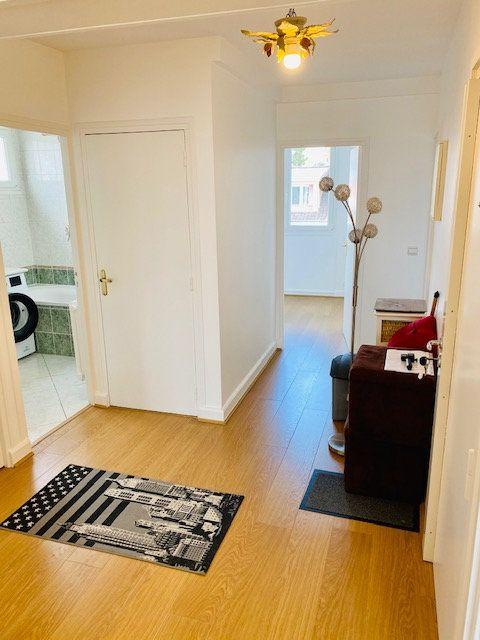 Appartement à louer 3 60.48m2 à Rosny-sous-Bois vignette-5
