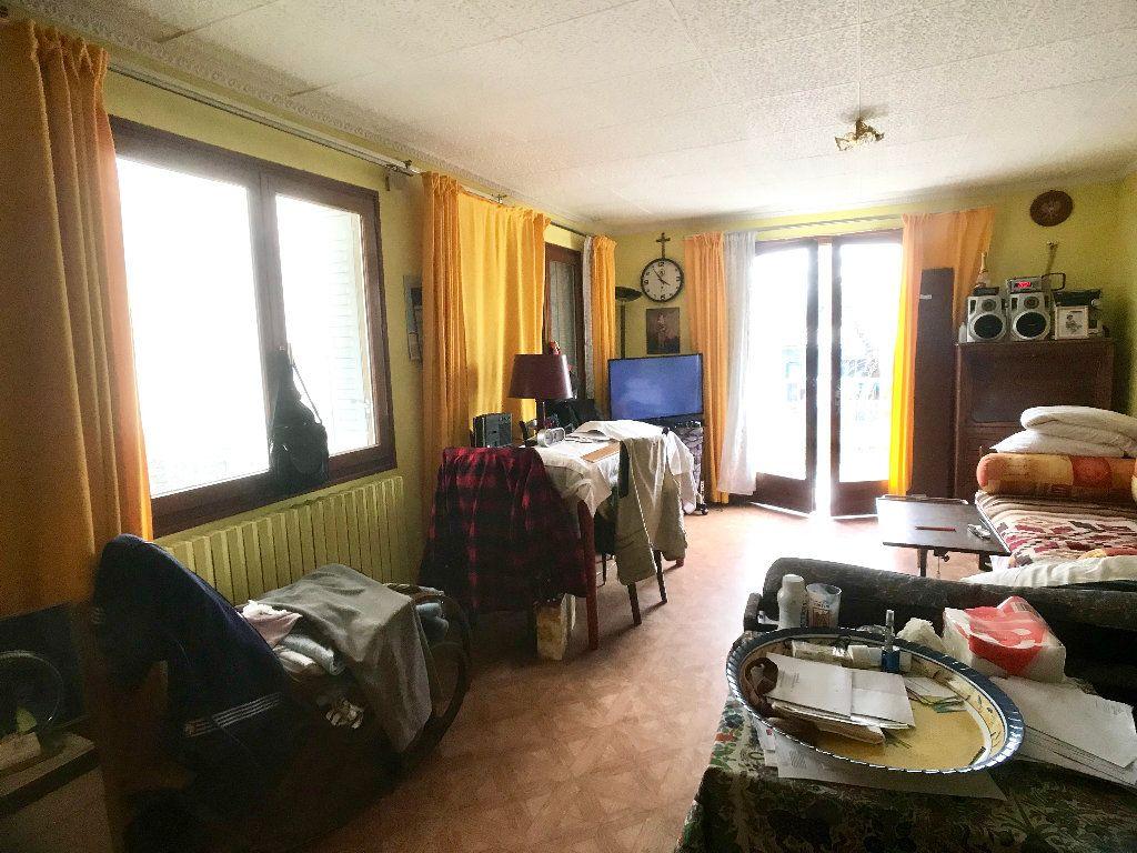Maison à vendre 4 71.25m2 à Bobigny vignette-5