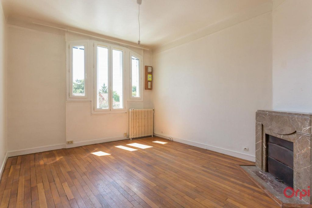 Appartement à louer 3 57.43m2 à Sainte-Geneviève-des-Bois vignette-1