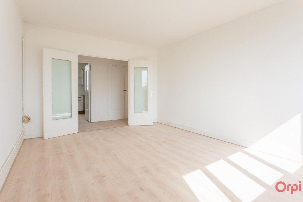 Appartement à louer 3 56m2 à Sainte-Geneviève-des-Bois vignette-2