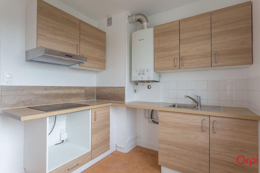 Appartement à louer 4 63m2 à Sainte-Geneviève-des-Bois vignette-4