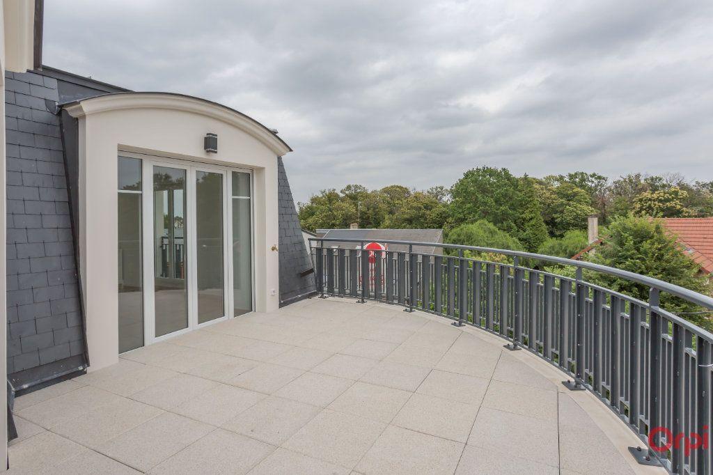 Appartement à louer 4 104.57m2 à Sainte-Geneviève-des-Bois vignette-6