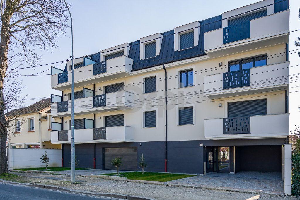 Appartement à louer 1 30.05m2 à Sainte-Geneviève-des-Bois vignette-1