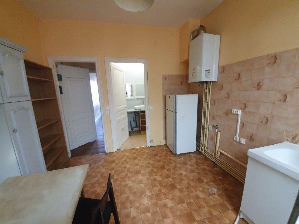 Appartement à vendre 2 61.68m2 à Reims vignette-4