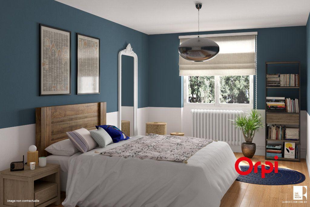 Appartement à vendre 4 93.73m2 à Lyon 8 vignette-2