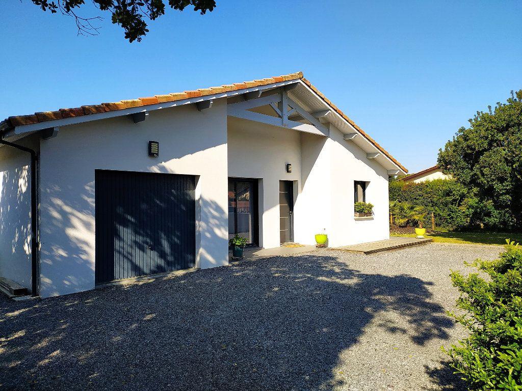 Maison à vendre 4 144m2 à Sanguinet vignette-1