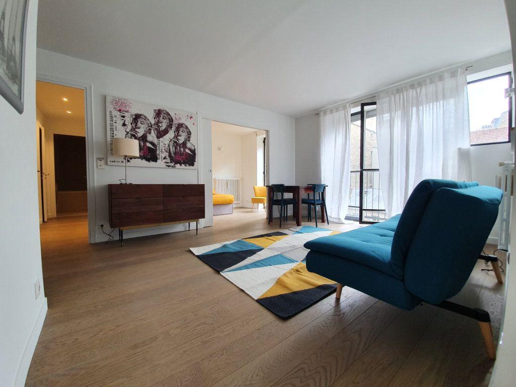 Appartement à louer 3 56m2 à Paris 15 vignette-2