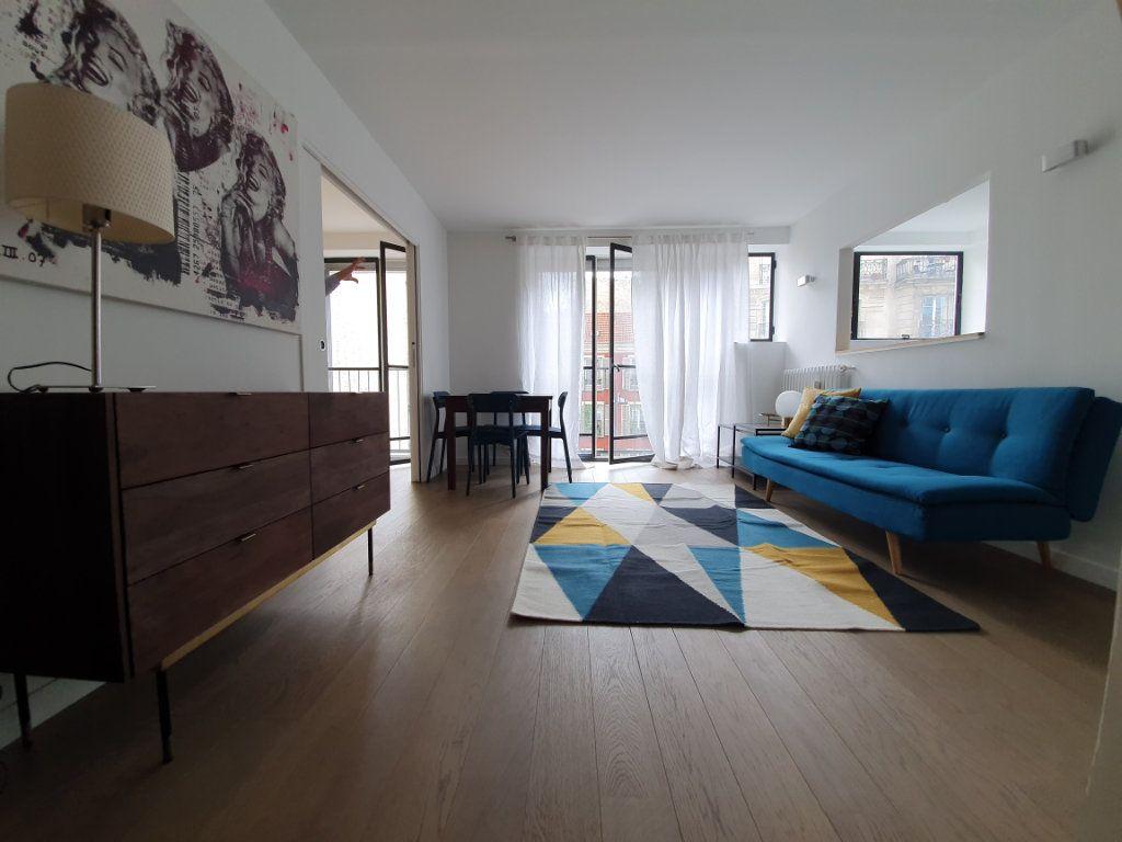 Appartement à louer 3 56m2 à Paris 15 vignette-3