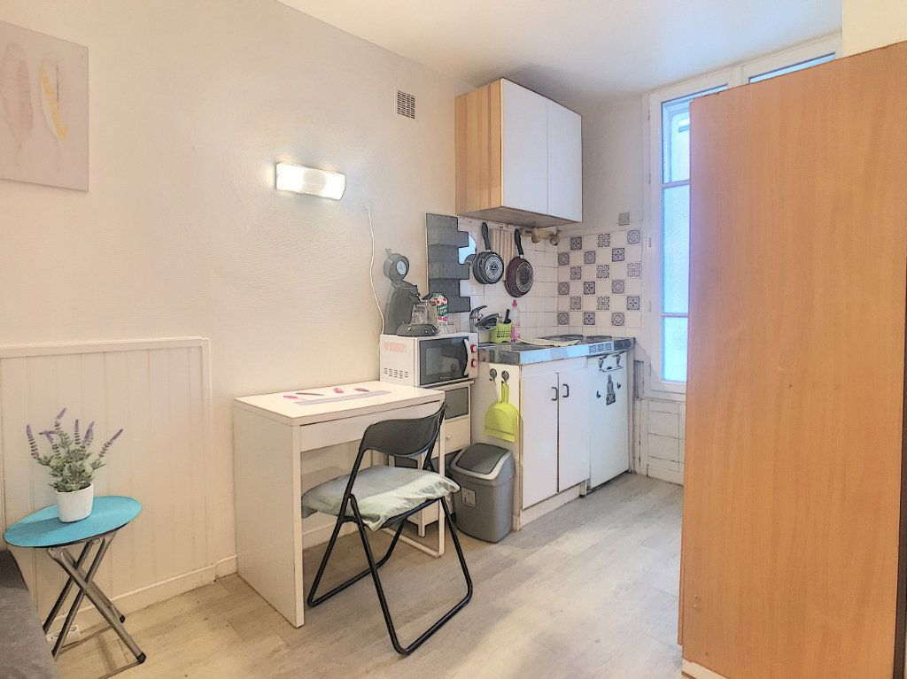 Appartement à louer 1 11.33m2 à Paris 14 vignette-2