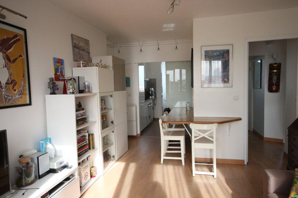 Appartement à vendre 4 62m2 à Paris 15 vignette-3