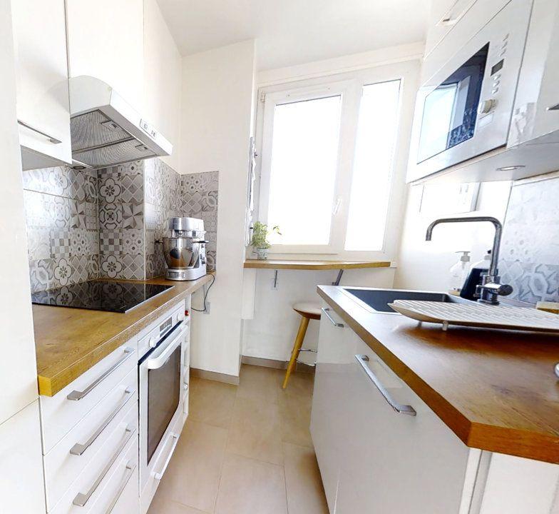 Appartement à vendre 4 62m2 à Paris 15 vignette-4