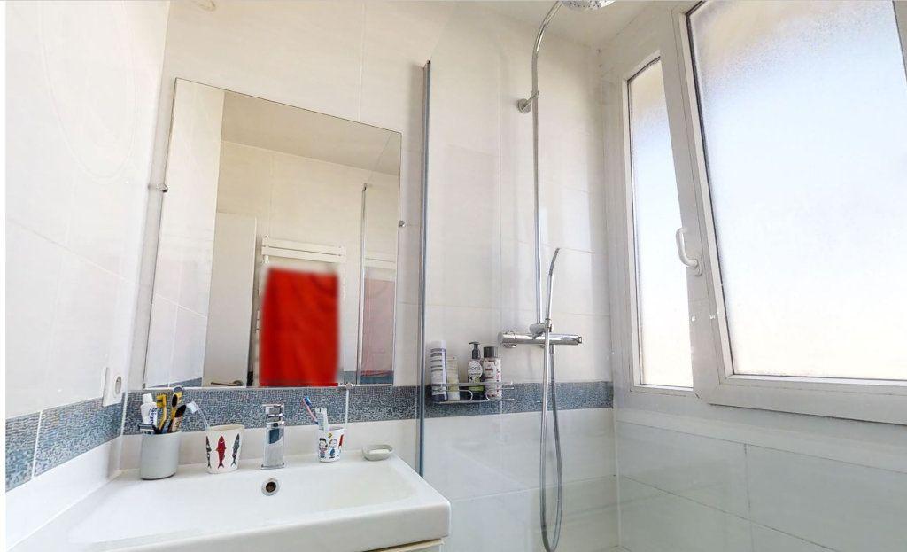 Appartement à vendre 4 62m2 à Paris 15 vignette-5