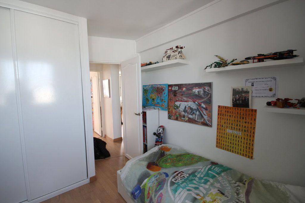 Appartement à vendre 4 62m2 à Paris 15 vignette-9