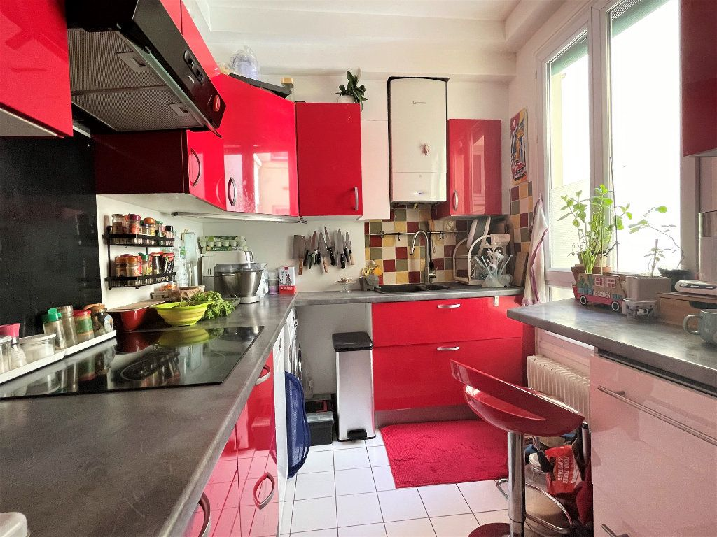 Appartement à vendre 3 57.27m2 à Paris 14 vignette-5