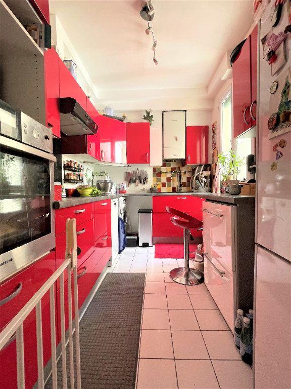 Appartement à vendre 3 57.27m2 à Paris 14 vignette-11